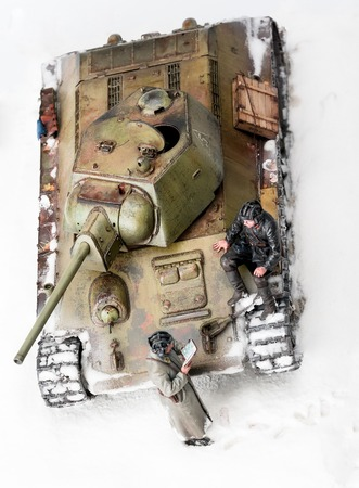 diorama: Legendary Soviet tank T-34 at war in the second world war. Diorama of winter view with officers. Top view
