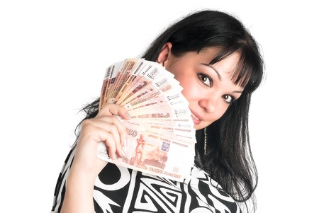 Young attractive woman with currency over white background photo