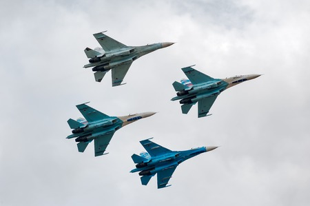 Nizhniy Tagil, Russia - September 25. 2013: Team of fighters SU-27 display of fighting opportunities of equipment with application of aviation means of defeat. RAE-2013 exhibition (Russia Arms Expo)