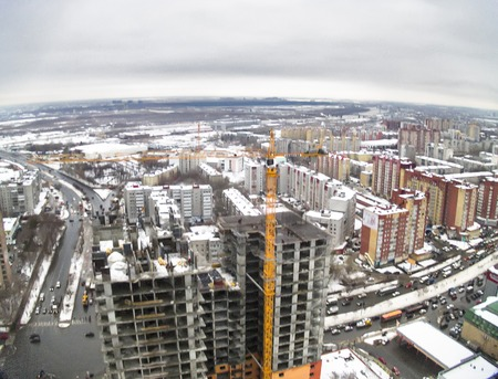 housing lot: Tyumen, Russia - October 30, 2014: Aerial view onto construction of conceptual housing estate of Fifty Fifty on 50 let Oktyabrya street