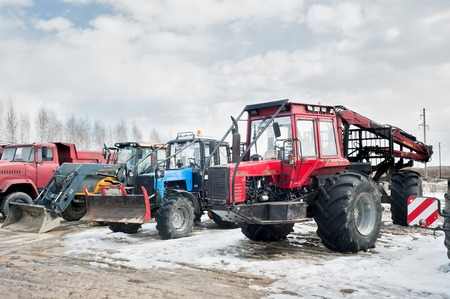 specialized: Tyumen, Russia - April 04. 2014: IV Tyumen specialized exhibition Agricultural Machinery and Equipment. Tractors and truck stand on open area Editorial