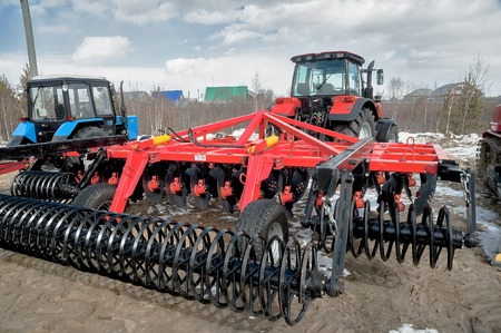 specialized: Tyumen, Russia - April 04. 2014: IV Tyumen specialized exhibition. Hinged equipment for tractor demonstration