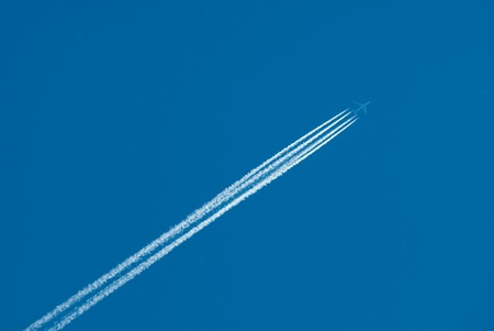 inversion: Airplane flies highly and leaves also inversion trace from engines