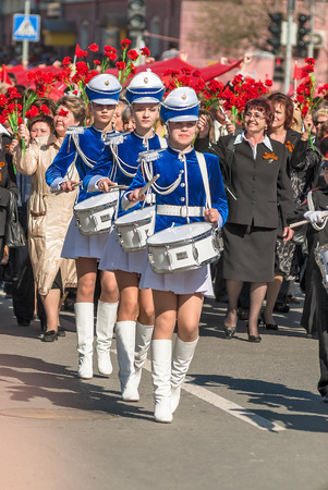 Tyumen, Russia - May 9. 2009: Parade of Victory Day in Tyumen. Drummer girls drum