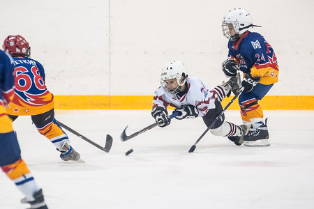 magnitogorsk: Tyumen, Russia - April 14, 2013: Hockey tournament on prize of name A.P.Vahrin among teams of children till 9 years old. Game between Rubin 04 (Tyumen) and Metallurg 04 (Magnitogorsk)