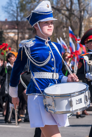 Tyumen, Russia - May 9. 2009: Parade of Victory Day in Tyumen. Drummer girl drums