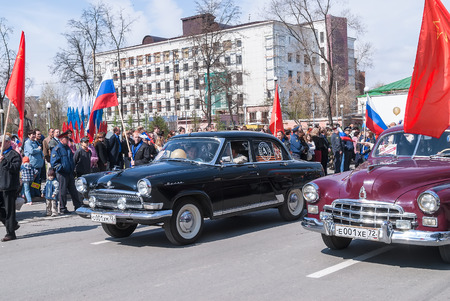 postwar: Tyumen, Russia - May 9. 2008: Parade of Victory Day in Tyumen. Old-fashioned cars of post-war release years participate in parade