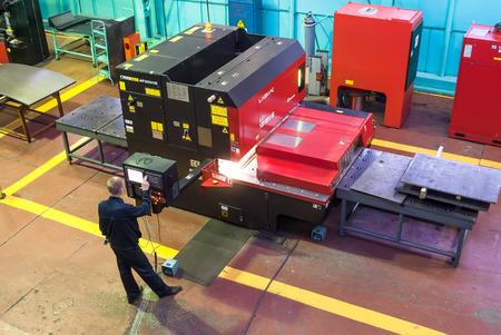 skilled operator: Tyumen, Russia - November 14, 2007: JSC Tyumenskie Motorostroiteli (Plant on production and repair of aviation engines). Technician operates computerized metalworking machine Editorial