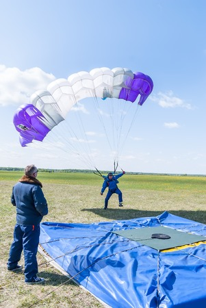 parachutists: Yalutorovsk, Russia - May 24, 2008: Competition of parachutists on landing accuracy on sport airdrome. Parachutist missed by landing point