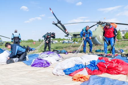 parachutists: Yalutorovsk, Russia - May 24, 2008: Competition of parachutists on landing accuracy on sport airdrome. Preparations of parachutists for new jump