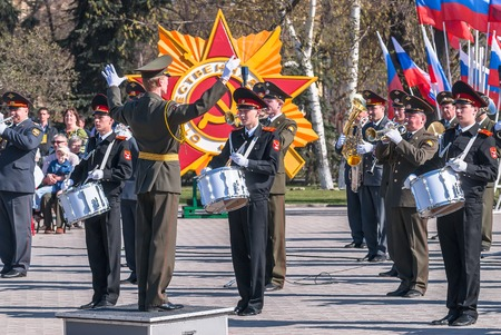 Tyumen, Russia - May 9. 2009: Parade of Victory Day in Tyumen. Mixed military orchestra from army, police and cadet musicians plays on Victory Day parade