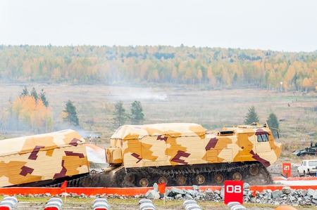tracked: Nizhniy Tagil, Russia - September 25. 2013: Tracked carrier DT-30P1 on demonstration range. It leaves after overcoming of water ford. Russia Arms Expo-2013 exhibition