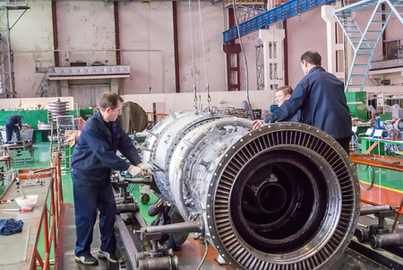 job engine: Tyumen, Russia - November 14, 2007: JSC Tyumenskie Motorostroiteli (Plant on production and repair of aviation engines). Workers assemble turbine of aviation engine