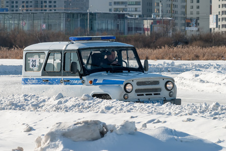 Tyumen, Russia - February 22, 2015: Ice autodrome Ice cult on Alebashevo lake. Competitions for police officers Special operation Ice. Offroad car race