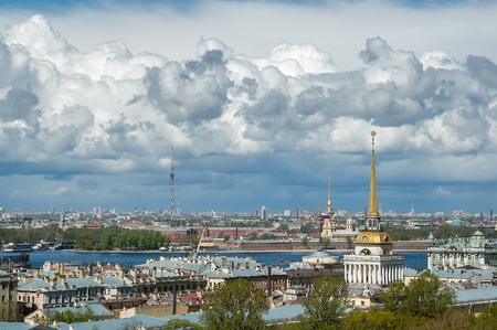 Saint-Petersburg, Russia - May 15, 2006: Main tower of Admiralty, Peter and Paul Cathedral and teletower, towering over roofs of St. Petersburg photo