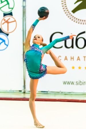 sports complex: Tyumen, Russia - April 4, 2015: All-Russian competitions in rhythmic gymnastics Spring grace. Sports complex Priboy. Young attractive girl shows own skill in exercise with ball Editorial