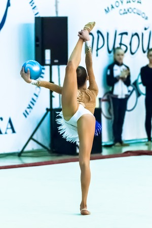 Tyumen, Russia - April 4, 2015: All-Russian competitions in rhythmic gymnastics Spring grace. Sports complex Priboy. Young attractive girl shows own skill in exercise with ball Editorial