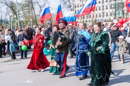 cossack parade: Tyumen, Russia - May 9. 2008: Parade of Victory Day in Tyumen. Cossack with bayan and women sings songs on procession