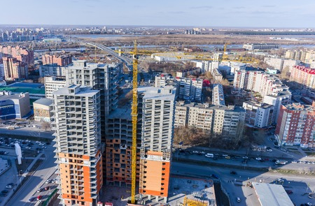 housing lot: Tyumen, Russia - April 28, 2015: Aerial view onto construction of conceptual housing estate of Fifty Fifty on 50 let Oktyabrya and Profsoyuznaya streets intersection