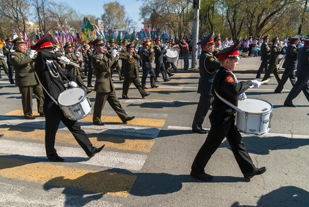 Tyumen, Russia - May 9. 2009: Parade of Victory Day in Tyumen. Mixed military orchestra from army, police and cadet musicians plays and walks on Victory Day parade