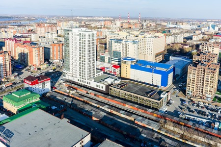 commercial tree service: Tyumen, Russia - April 28, 2015: Aerial view onto Business house Pyotr Stolypin and other large business centers