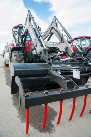 specialized job: Tyumen Russia April 04. 2014: IV Tyumen specialized exhibition quotAgricultural Machinery and Equipmentquot. Agricultural wheel loader demonstration