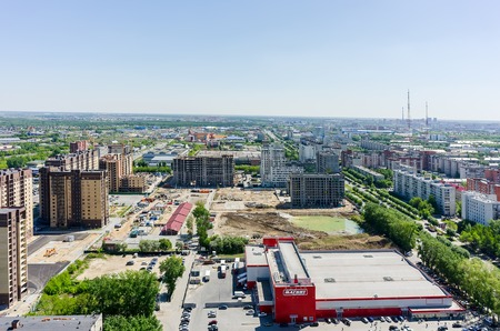 housing lot: Tyumen, Russia - May 25, 2015: Aerial view onto Magnet hypermarket and Central and Novin residential district construction. Between 50 let Oktyabrya and Harkovskaya streets
