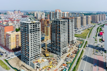 housing lot: Tyumen, Russia - May 30, 2015: Aerial view onto construction of twenty-storied residential houses on Gazovikov street