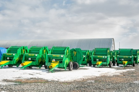 intended: Tyumen, Russia - April 04. 2014: IV Tyumen specialized exhibition Agricultural Machinery and Equipment. Press sorters with constant camera of pressing are intended for selection of hay rolls, straw