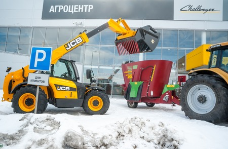 specialized job: Tyumen, Russia - April 04. 2014: IV Tyumen specialized exhibition Agricultural Machinery and Equipment. Agricultural wheel loader demonstration on platform open-air