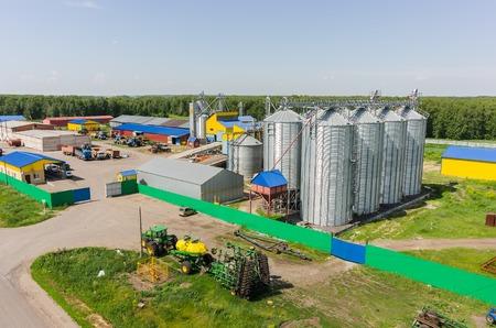 Novikova, Russia - June 18, 2015: Aerial view onto modern machine yard of agricultural firm Russian Field. Tyumen region