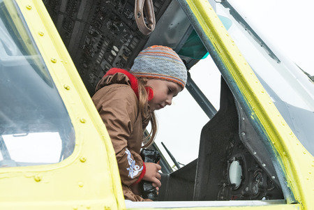 heliport: Tyumen, Russia - August 23, 2008: Air show On a visit at UTair in heliport Plehanovo. Girl sitting in cabin of MI-8 helicopter