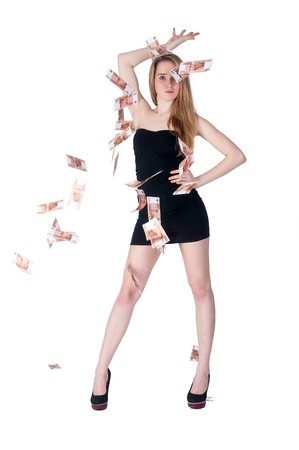 roubles: Attractive young woman stands among flying russian currency - roubles Stock Photo