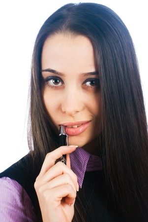 deep thought: Young beautiful woman in deep thought while biting on pen Stock Photo