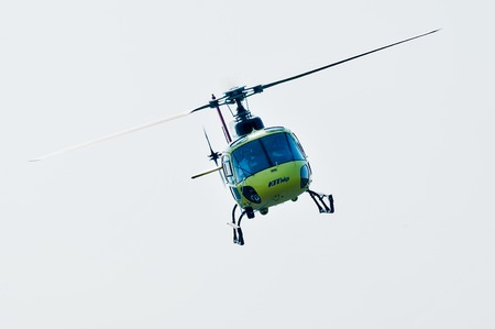 piloting: Tyumen, Russia - August 11, 2012: On visit at UTair airshow in heliport Plehanovo. Piloting of Eurocopter AS-350 shows flying opportunities. Facade view