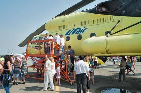heliport: Tyumen, Russia - August 11, 2012: Air show On a visit at UTair in heliport Plehanovo. Passengers make landing in Mi-10K helicopter