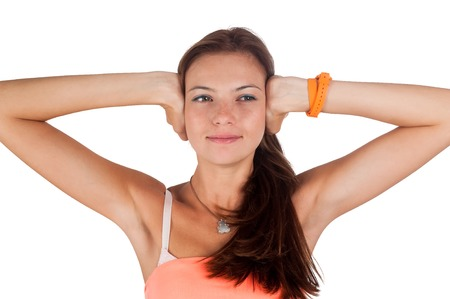 Attractive woman covering her ears - Hear no evil gesture over white background