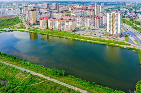 sameness: Tyumen, Russia - July 29, 2015: Aerial view on city quarters. Tura neighborhood