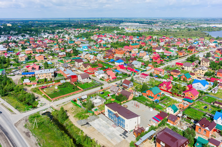 sprawl: Tyumen, Russia - July 29, 2015: Aerial view onto housing estates in Lesobaza residential district