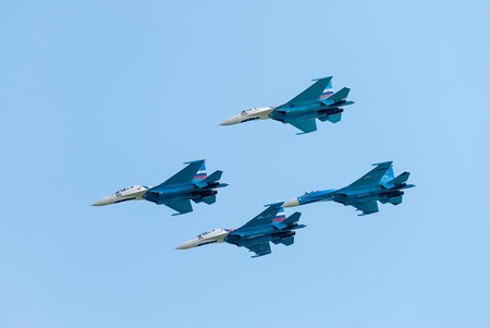 Nizhniy Tagil, Russia - July 12. 2008: Group flight of russian highest pilotage team on SU-27. Display of fighting opportunities of equipment with application of aviation means of defeat Editorial
