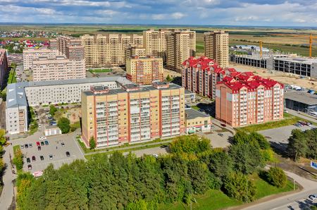 town houses: Tyumen, Russia - August 9, 2015: Aerial view on sleeping neighborhood in  Star City complex with new houses Editorial