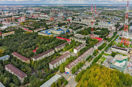 number 16: Tyumen, Russia - August 25, 2015: Bird eye view on residential district with TV center on Permyakova street. New building of school number 16 in center