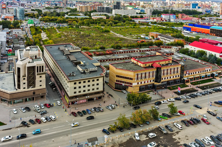 machinetool: Tyumen, Russia - August 25, 2015: Demidov stan office buildings and waste ground on place of demolished machine-tool factory. Maxima Gorkogo street