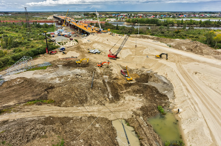 Tyumen, Russia - August 29, 2015: Aerial view of East Round road construction with bridge over Tura river Éditoriale