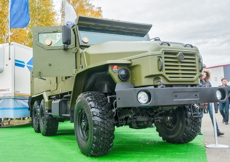 armored truck: Nizhniy Tagil, Russia - July 12. 2008: Visitors examine military equipment on exhibition range. Armored truck URAL-4320 of increased passability with wheel formula 6�6. RAE-2008 exhibition
