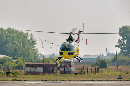 piloting: Tyumen, Russia - August 11, 2012: On a visit at UTair airshow in heliport Plehanovo. Piloting of Eurocopter AS-350 shows flying opportunities Editorial