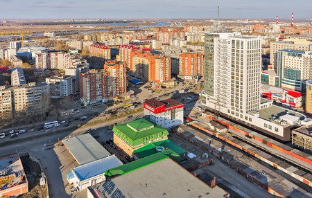 residential tree service: Tyumen, Russia - April 28, 2015: Aerial view onto Pyotr Stolypin business house, construction shops and residential district on 50 let Octyabrya street
