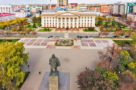 establishment states: Tyumen, Russia - September 17, 2015: Aerial view onto monument to Lenin and building of Tyumen region Government Stock Photo