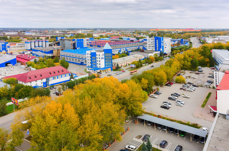 housebuilding: Tyumen, Russia - September 4, 2015: Aerial view onto factory of Tyumen House-building Company and other industrial firms Editorial
