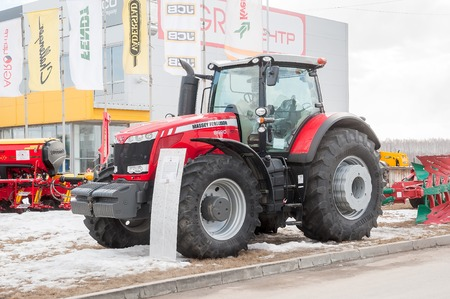 specialized job: Tyumen, Russia - April 04. 2014: IV Tyumen specialized exhibition Agricultural Machinery and Equipment. Tractor demonstration on platform open-air